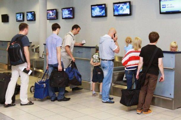 У стойки регистрации в аэропорту